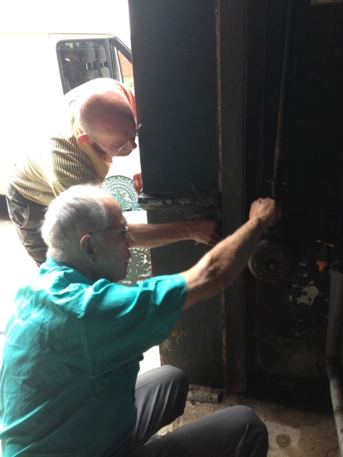 Colin and David access the shutter mechanism and fix it this morning. One of the big shutters has been stuck down since Sunday.